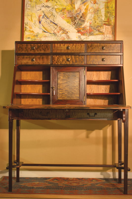The Kaya secretaire is made from ebony, congolo, quilted poplar, cherry and leopard wood. The desk features a leather writing surface.