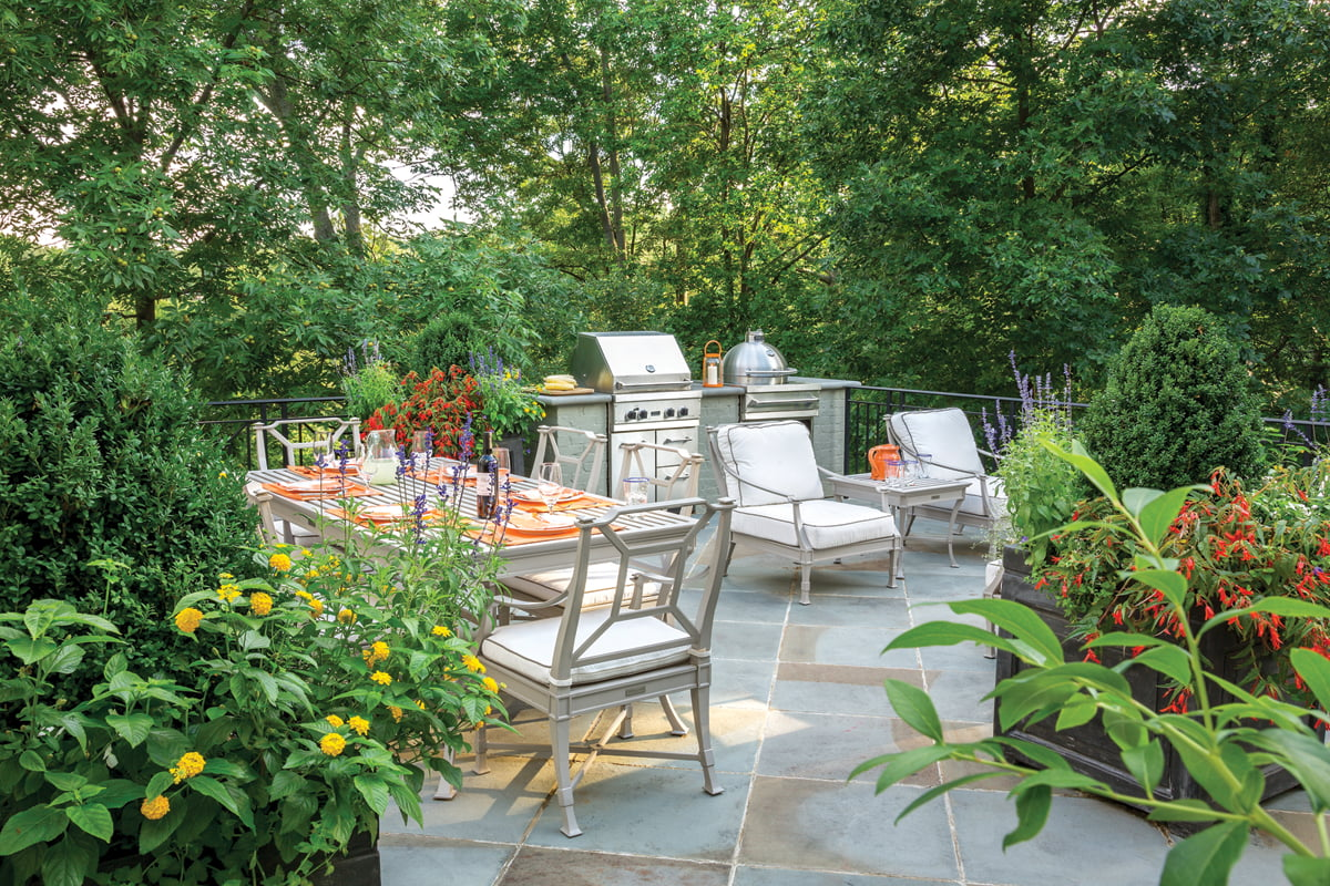 A flagstone terrace atop the garage is a unique perch on which to relax.