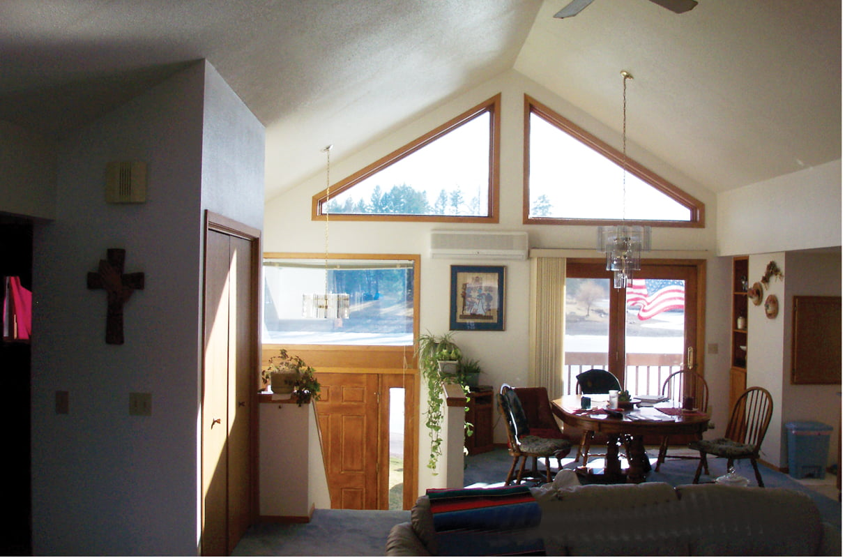 The original gabled wall with small windows did not take advantage of the home's majestic surroundings.