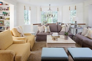 The family room features chairs and sofas from Lee Industries and custom ottomans from Lucy Smith Designs.