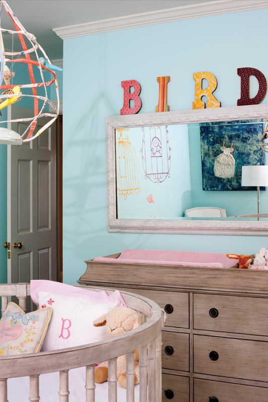 Bridget's bedroom centers on a round crib from Restoration Hardware Baby.