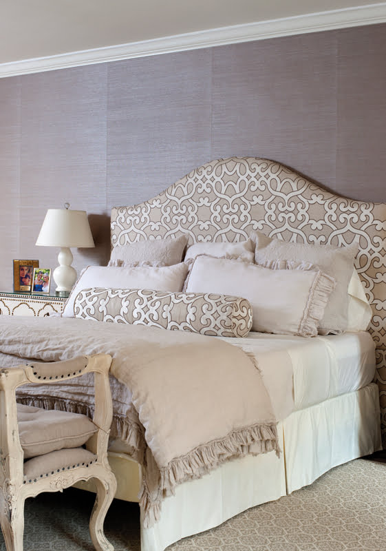 In the master suite, the bed features a custom headboard covered in Schumacher fabric.