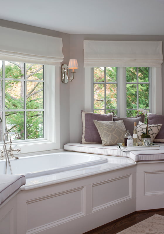 Pillows on platforms surrounding the tub in the master bath are a mix of custom and Pottery Barn designs.