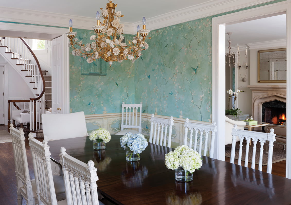 A vintage Italian chandelier hangs over the dining table.