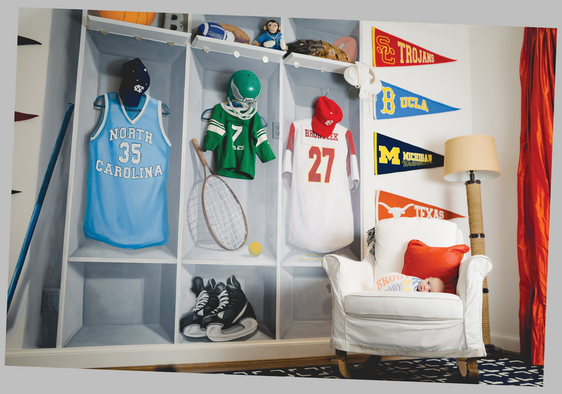 A mural depicting a boys' locker room adorns baby Brody's bedroom.