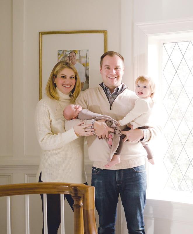 Ashley Taylor Bronczek and Matt Bronczek pose with daughter Bridget and newborn son Brody.