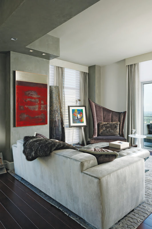 One of the living room's two seating areas is anchored by a large copper work by Elizabett Gudmann.
