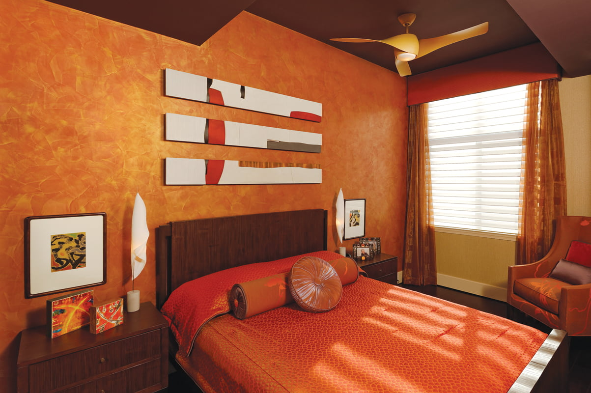 In the guest bedroom, a three-piece sculpture by Pascal Pierme hangs above the bed.