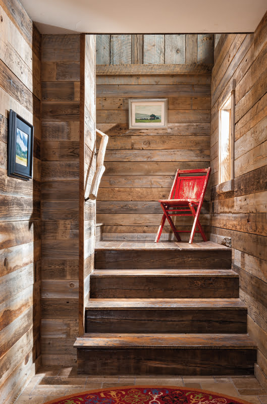 The new entry stairs are clad in reclaimed wood.