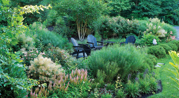 Botanical Decorators creates an idyllic poolscape in a secluded backyard retreat. Photo by Roger Foley.
