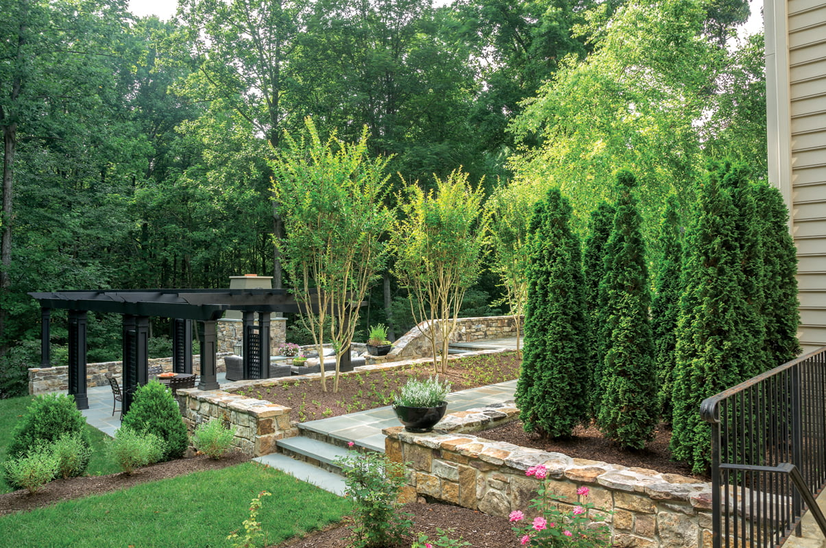 Walls crafted from Western Maryland stone delineate outdoor living areas.
