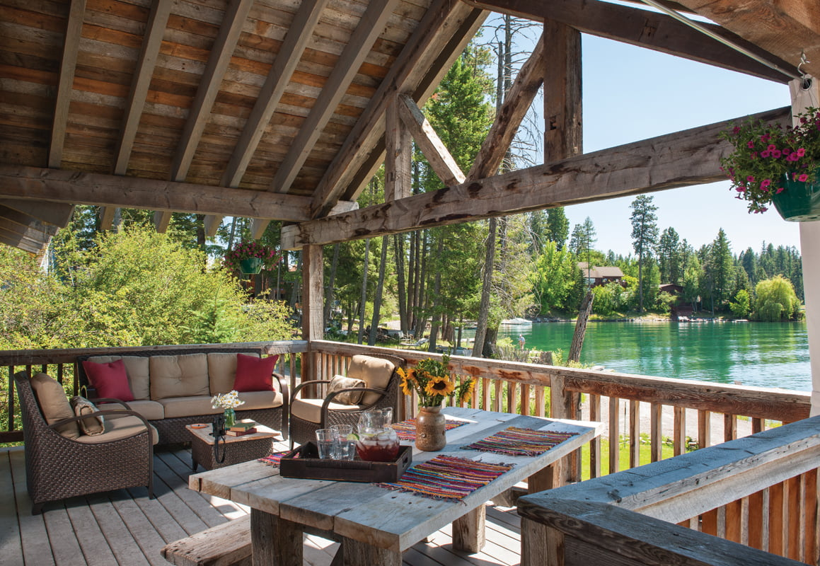 The family often gathers for meals on a new porch overlooking the dock.