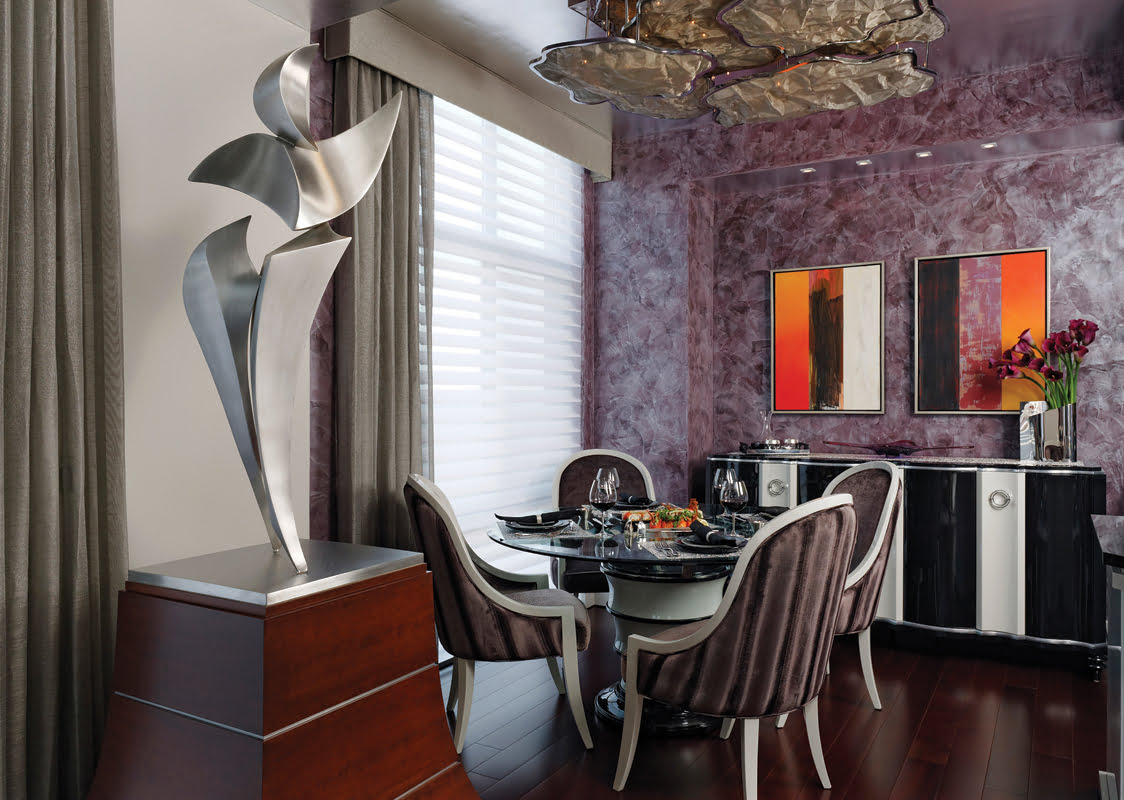 A light fixture made of metal mesh evokes the feeling of clouds in the dining room.