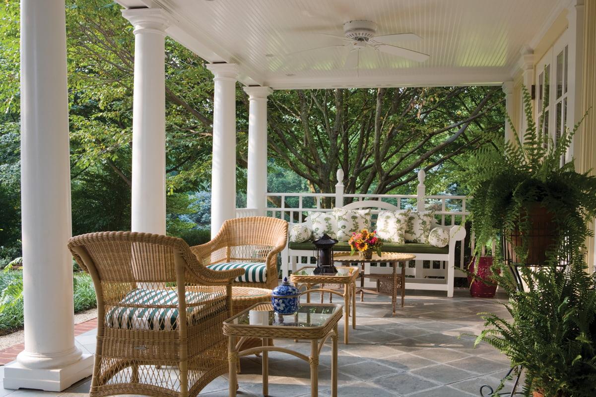 The back veranda overlooks a manicured garden.
