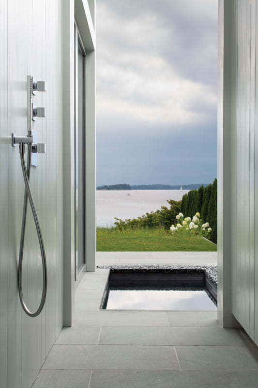 The master bath leads to an outdoor shower and hot tub seamlessly installed in stone.