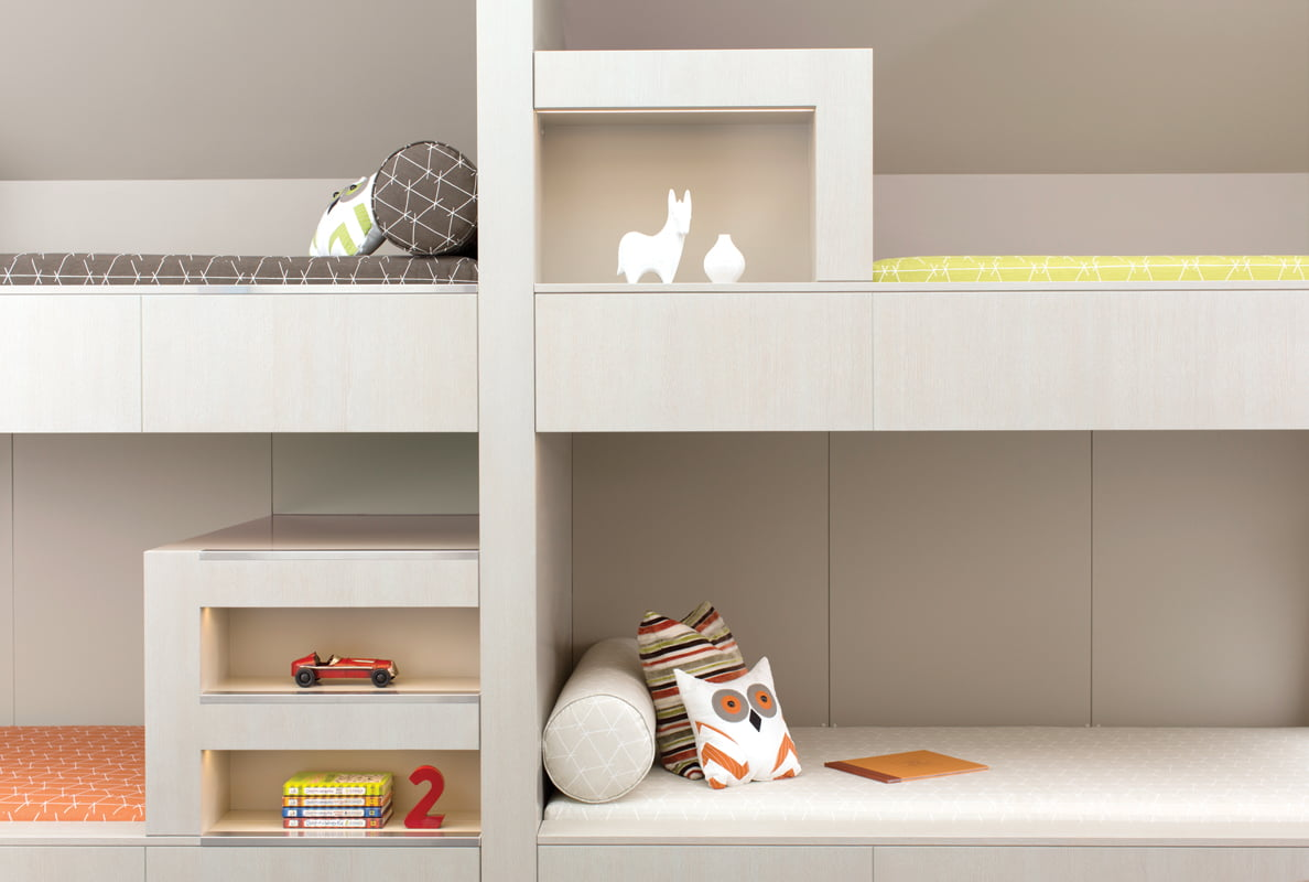 Built-in beds and shelving provide storage in the bunk room.