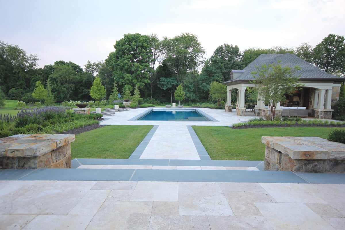 French country style home design magazine a large travertine patio near the pool is perfect for entertaining sciox Choice Image