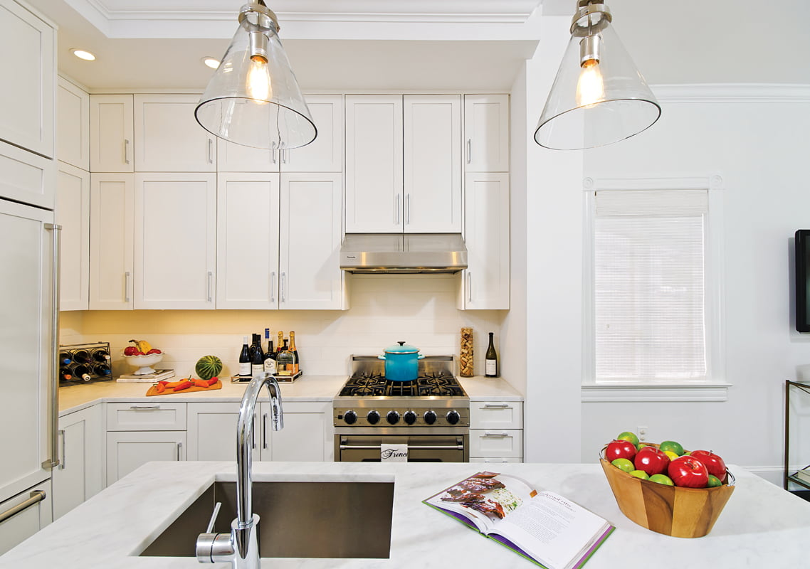The new kitchen maximizes space with ceiling-height cabinets.