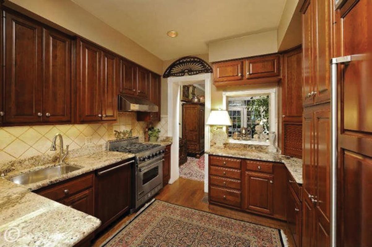 A sense of history home design magazine - Closed kitchen design ...