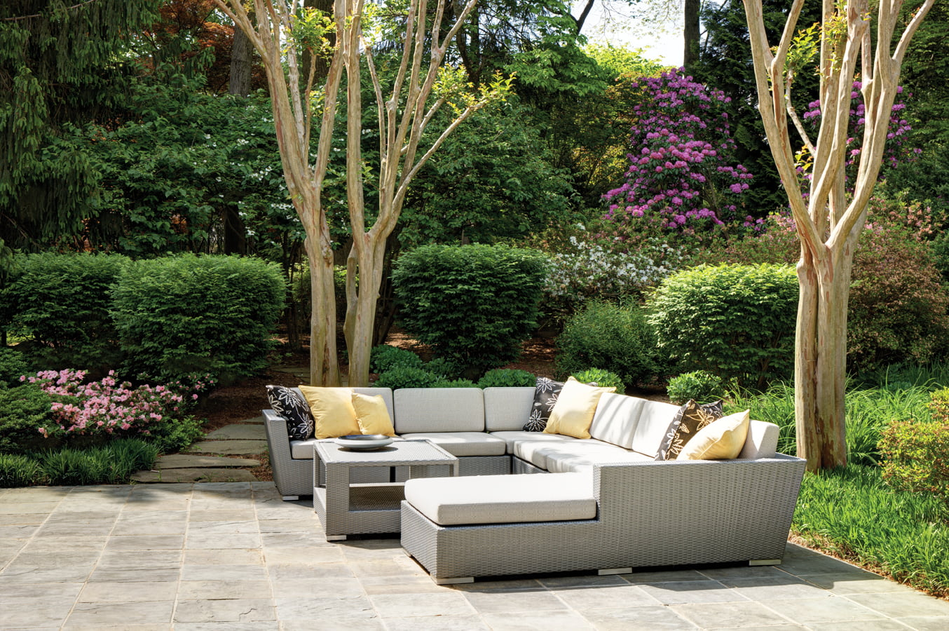 Furniture by Neoteric Luxury adorns the patio.