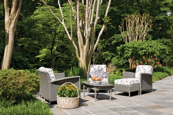 A grouping of patio furniture is by JANUS et Cie.