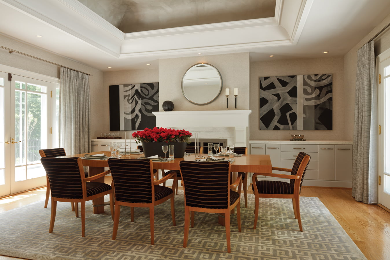 In the dining room, the custom table is by Evanson Studios and the chairs are by David Edward.