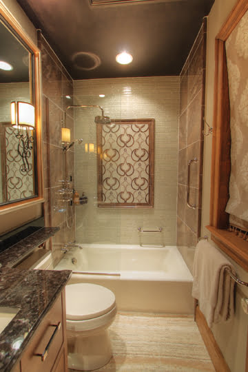 A glass-and-marble cut mosaic-tile accent mural behind the tub provides a focal point.