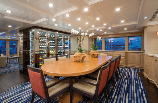 Bottles are secured on mirrored, floor-to-ceiling shelves on the dining side.