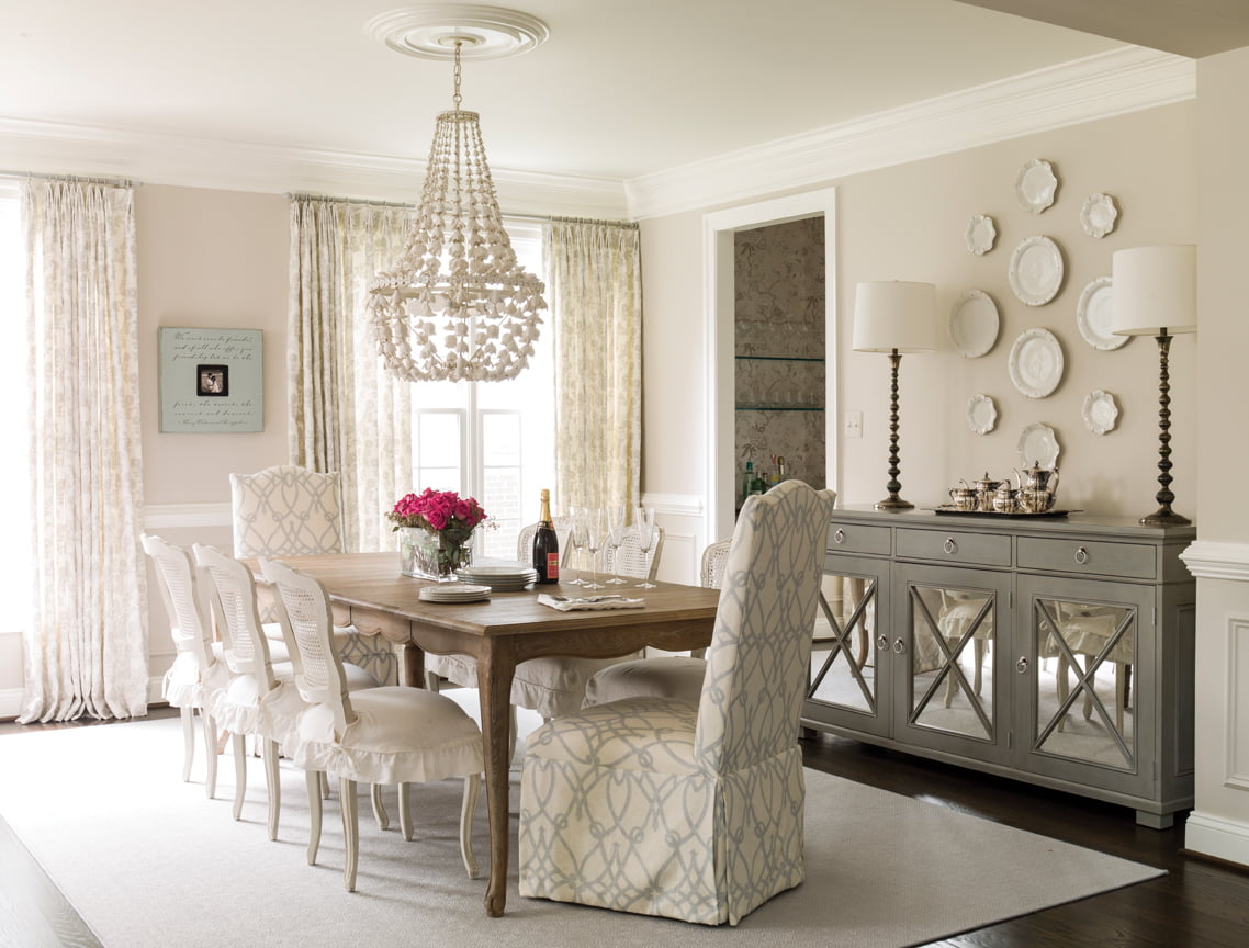 A distinctive Oly Studio chandelier is a focal point in the dining room.