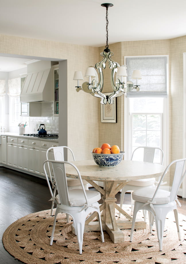 A Tritter Feefer table and metal chairs sit atop a jute rug in the breakfast nook.