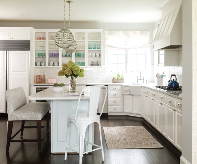 In the kitchen, glassware and pottery add a dash of pastel color.