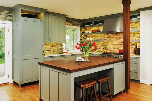 A spacious island topped with oiled walnut centers the kitchen.