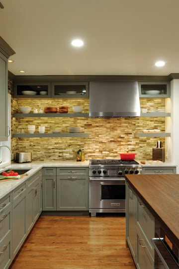 A cabinet-to-ceiling glass-tile backsplash makes a strong visual statement.