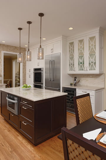 A new island with a Taj Mahal quartzite top is now dedicated to food prep.