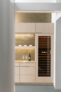 The wine refrigerator in the butler's pantry.