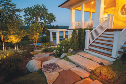 From the house, stone steps lead to a secluded hot tub. © Jay Stearns
