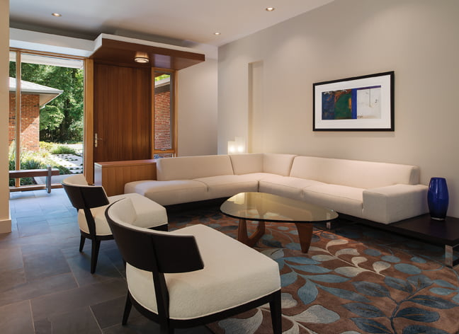 The living room (opposite) is furnished with chairs and a sofa from Theodores and a Noguchi coffee table.