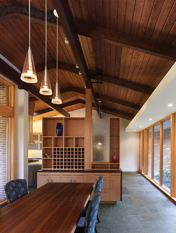 The dining room combines a walnut Bonaldo Big Table and Baker chairs.