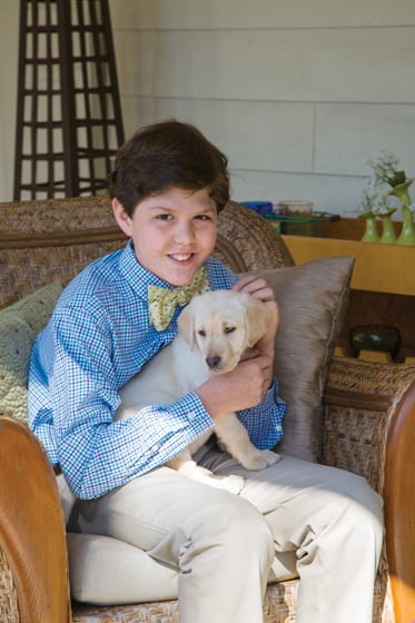 Kemp holds Roux, the family's new Labrador puppy.