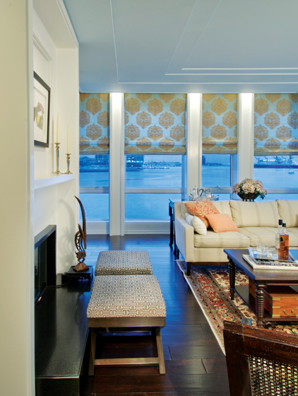 A wall of windows on the second floor captures the immediacy of dramatic harbor views.