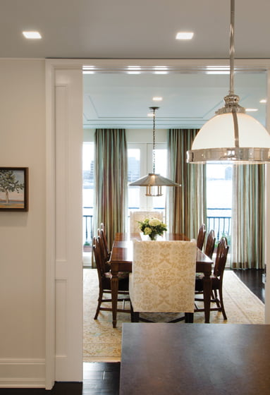 Pendant fixtures lend a nautical feel to the dining room.