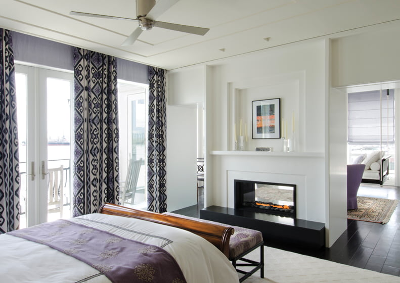 A double-sided fireplace serves the master bedroom and adjoining sitting room.