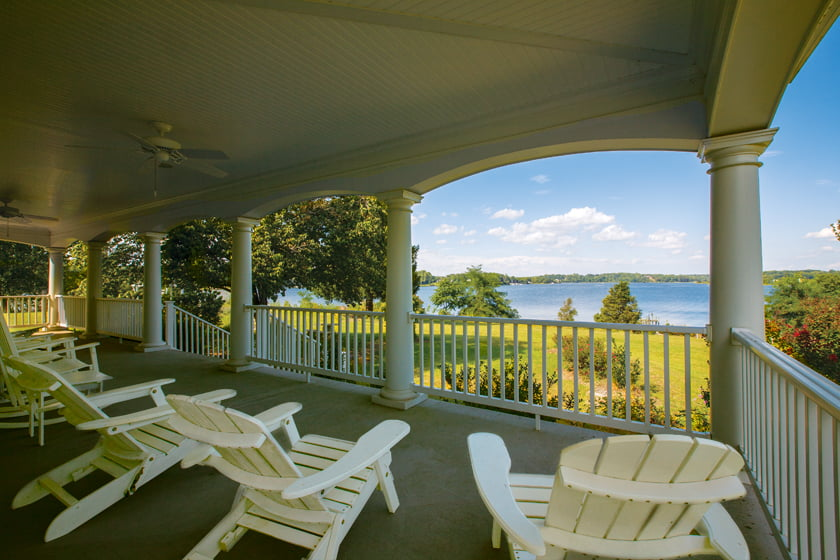 The columned, 12-foot-wide veranda frames a picturesque ivew of Breton Bay, which flows into the Potomac River. © Geoffrey Hodgdon