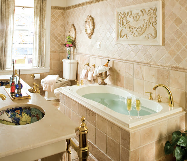 The Murray Suite's bath features a whirlpool tub and vanity topped with Botticino marble.