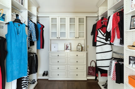 The master closet, by David Chin of Closets by Design.