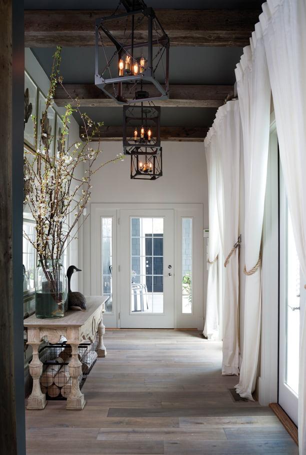 Engineered-wood floors with the look of driftwood create coastal feel in the foyer.