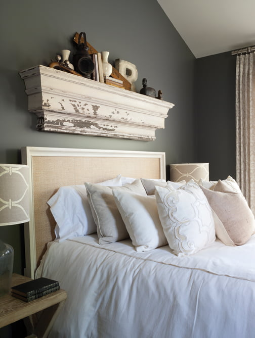 A bedstead from Universal Furniture pops against charcoal walls.