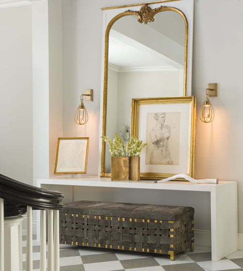 Windsor Smith's collection includes the hand-woven, suede Elis Bench and the Athena Sconce. arteriorshome.com