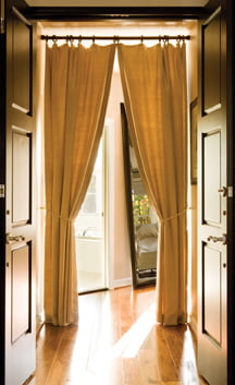 A romantic vestibule with Douglas fir doors and draperies leads to the master suite.