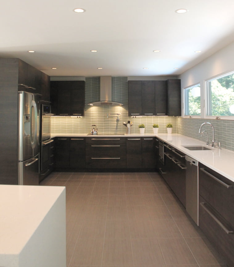 A Great Falls kitchen reflects the home's Mid-Century style with porcelain floors and glass tile.